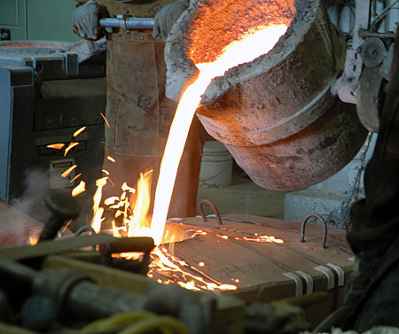Molten bronze is poured at Laran Bronze in Chester for the first stages of casting of 'Keys To Community,' a bronze sculpture of Ben Franklin for downtown Philadelphia