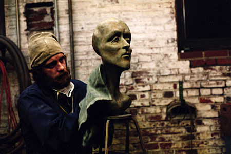James Peniston works a plaster sculpture in his West Philadelphia studio