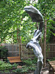 Bird In Hand, a 2004 bronze sculpture by James Peniston. Private collection, Philadelphia