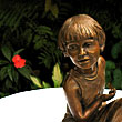 Olivia, a 2004 bronze sculpture by James Peniston. Private collection, St. Louis, Missouri